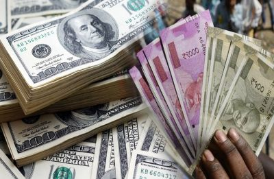 Rupee gains 26 paise to 70.86 against US Dollar as Fed keeps rates unchanged
