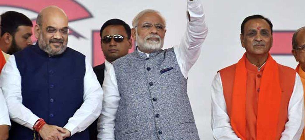 Prime Minister Narendra Modi with BJP chief Amit Shah and Gujarat Chief Minister Vijay Rupani. (File photo: PTI)