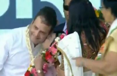 On Valentine's Day, Congress woman supporter 'kisses' Rahul Gandhi at Valsad rally