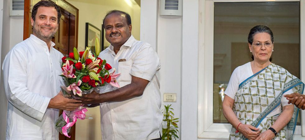 Karnataka Chief Minister and JDS leader HD Kumaraswamy with Congress chief Rahul Gandhi and Sonia Gandhi. The Congress quickly backed the JDS and formed a post-poll alliance under Kumaraswamy in order to snatch the state from the BJP. (File photo: PTI)