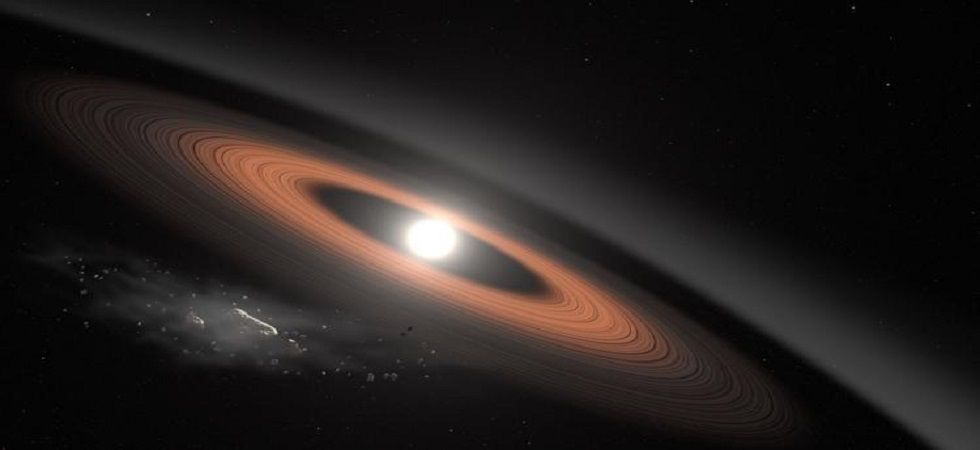 The star named J0207 is an earth-sized remnant of a Sun-like star that has died and is ringed by dust and debris. (Photo: Scott Wiessinger/NASA's Goddard Space Flight Center)