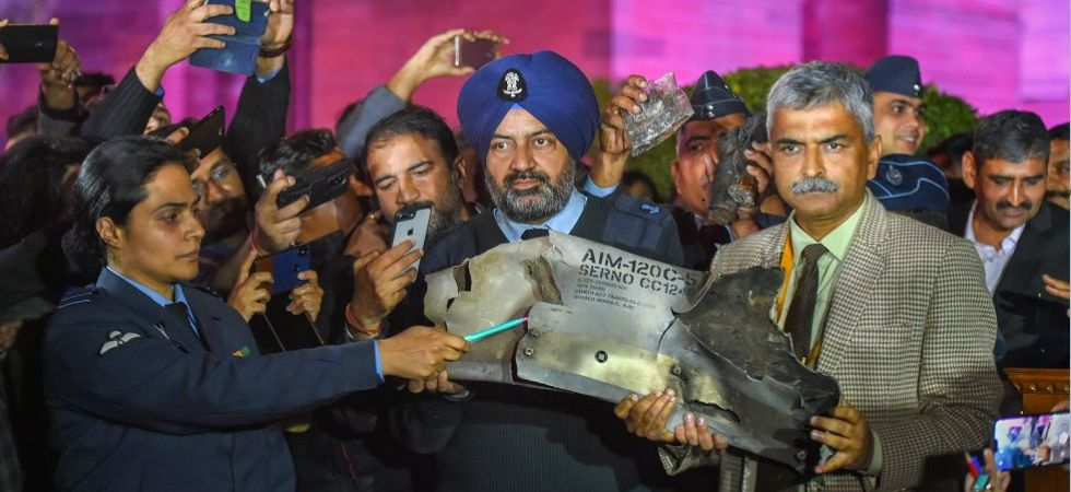 Indian Air Force officials show sections of an exploded Amraam missile, which was fired by Pakistan Air Force (PAF) F-16s, at an IAF, Army and Navy joint press conference at South Block in New Delhi on February 28, 2019. (PTI photo)