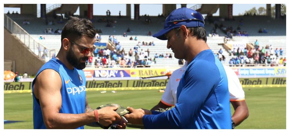 MS Dhoni handed out army-style caps to the Indian cricket team as they paid tribute to the jawans killed in the Pulwama terror attack. (Image credit: BCCI Twitter)