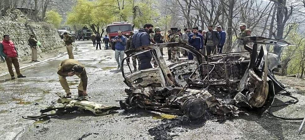 Mangled remains of a car which exploded near a CRPF convoy on the J-K at Banihal (Photo Source: PTI)