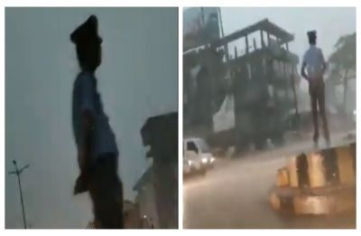 Duty above everything: Assam traffic cop stands guard amidst thunder storm, becomes star on social media