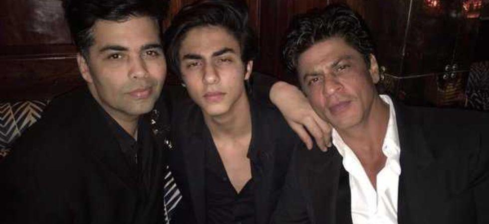 Karan Johar with Shah Rukh Khan and Aryan Khan.