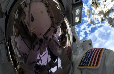 Spacewalking astronauts tackle battery, cable work outside ISS
