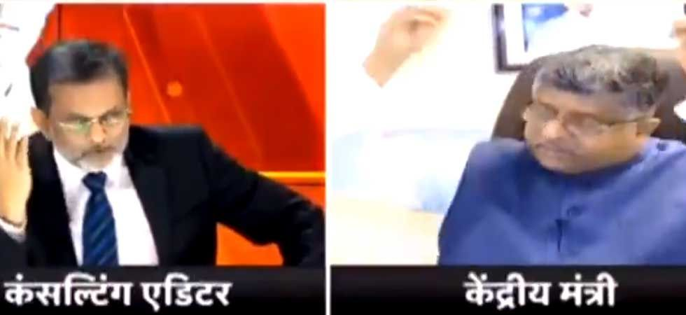 Union Minister Ravi Shankar Prasad (Right) removing headphones during the interview (Screen Shot: Twitter/@zainabsikander)
