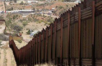 350 migrants 'break violently' into Mexico as new caravan arrives