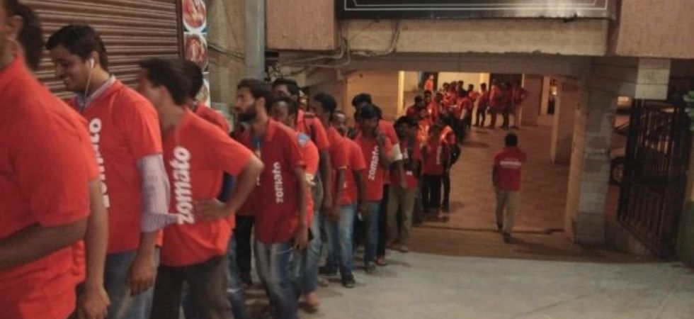 Zomato delivery boys are queuing up outside a restaurant in Hyderabad.