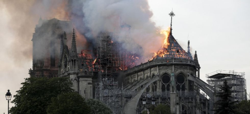 Thousands of Parisians and tourists watched in horror Monday as flames engulfed the building. (IANS photo)