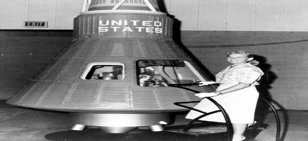 Jerrie Cobb poses next to a Mercury spaceship capsule (Photo: NASA)