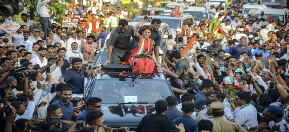 Priyanka Gandhi Vadra waves at party workers during a roadshow in Kanpur (Photo Source: PTI)