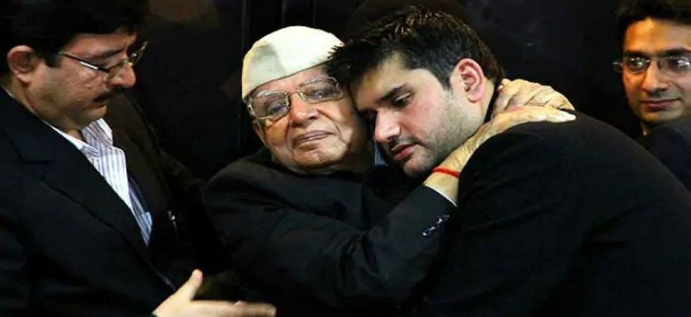 Rohit Shekhar Tiwari hugging his father ND Tiwari (File Photo/PTI)