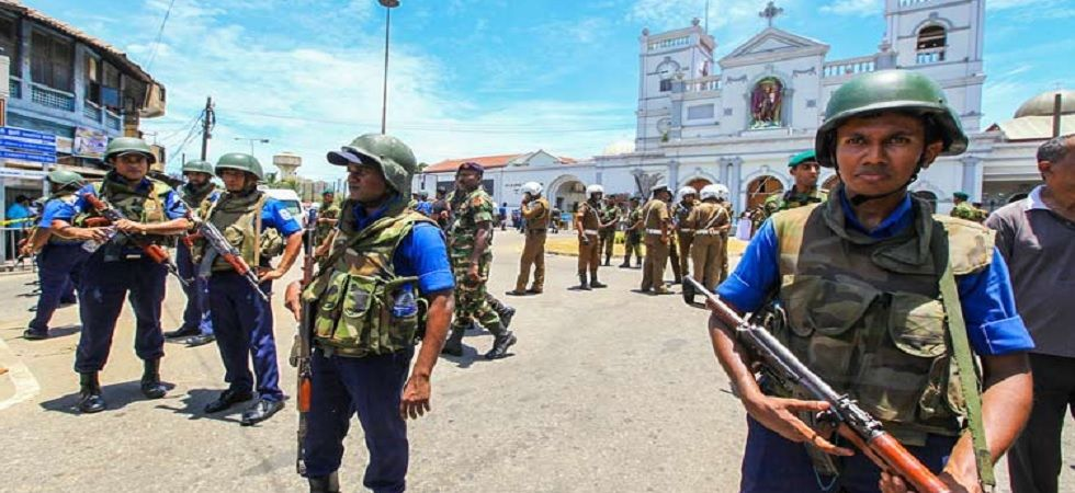 Security personnel standing guard outside a church in Sri Lanka after blasts (PTI Photo)