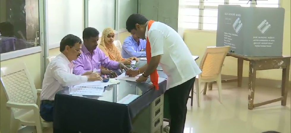 BJP MP candidate from Shimoga BY Raghvendra casts his vote at a polling booth in Shikaripura. (Photo: ANI)