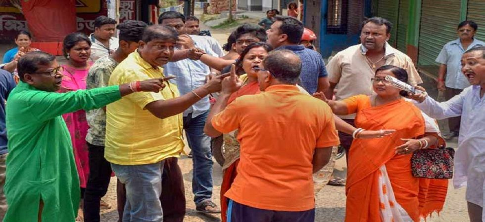 Trinamool Congress and BJP workers in a scuffle outside a polling station. (PTI/file)