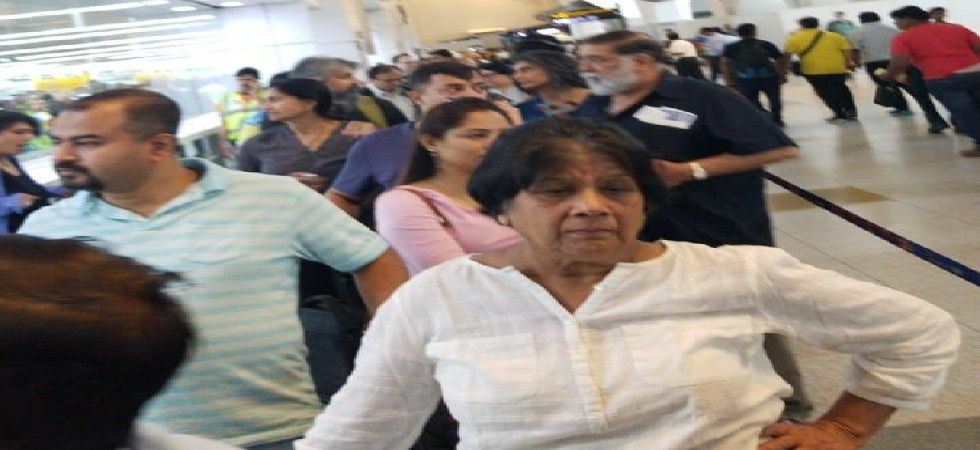 Hundreds of passengers had a harrowing time at Delhi airport early Monday due to the problems in the immigration system server affecting six international flights and resulting in long queues at the counters. (Photo: ANI)
