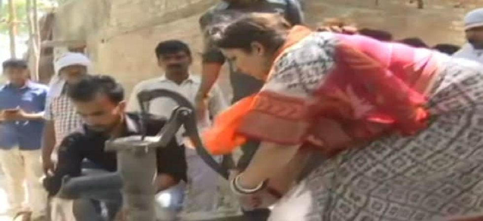 In a video which surfaced online, she was seen using a hand-pump briefly as villagers fetched water and tried to douse the blaze, before fire tenders reached the stop. (ANI)