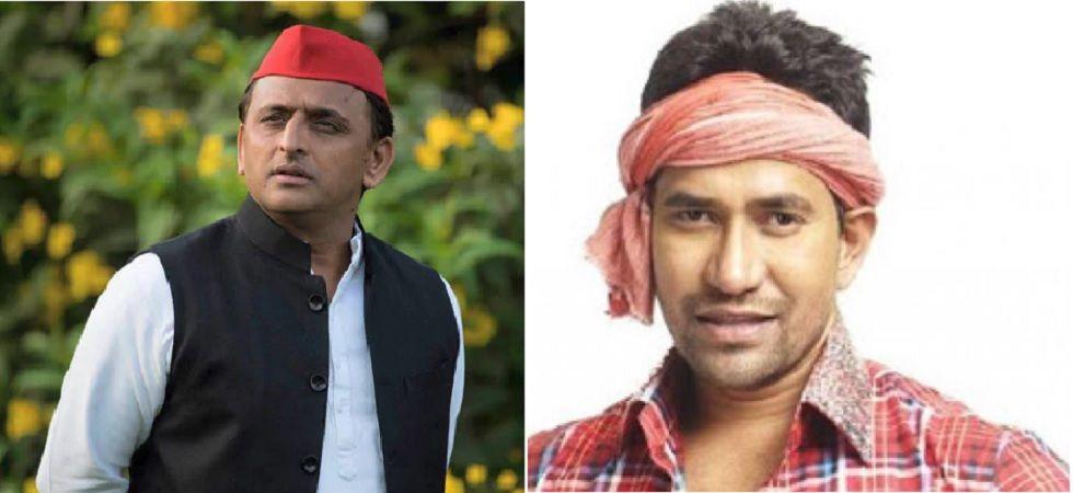 Samajwadi Party chief Akhilesh Yadav and BJP candidate Dinesh Lal Yadav alias Nirahua (File photo)