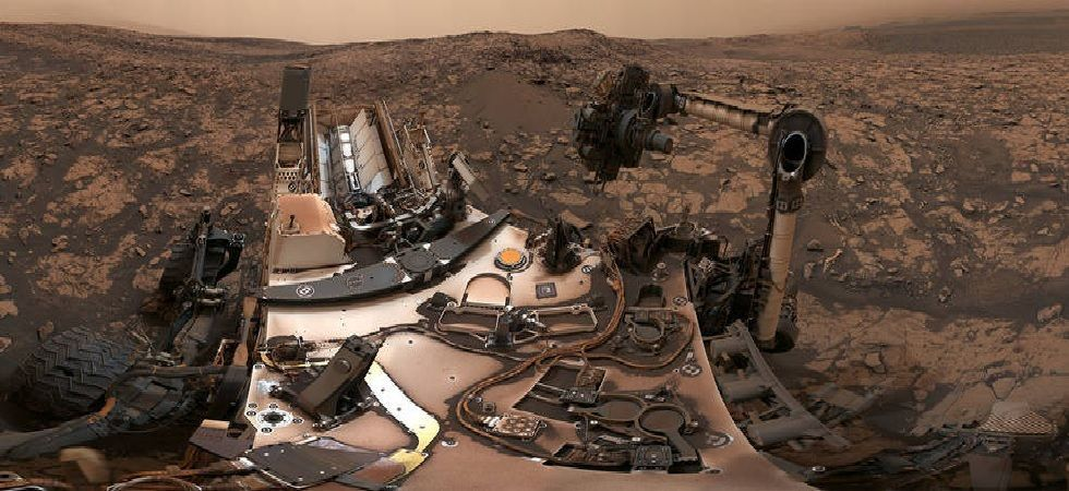 Rain on Mars: The dust storms probably absorbed heat and warmed up the atmosphere and made it impossible for the planet to form ice clouds (File Photo)