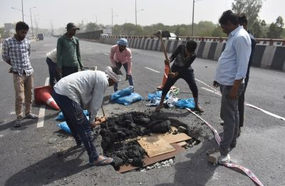 IN PICS: 4-feet-deep hole on Hero Honda Chowk flyover in Gurugram throws traffic out of gear