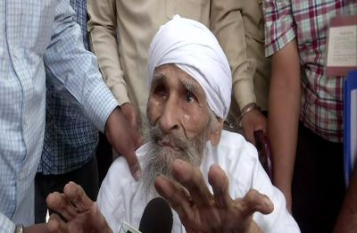 111-year old Bachan Singh, the oldest voter in Delhi casts vote