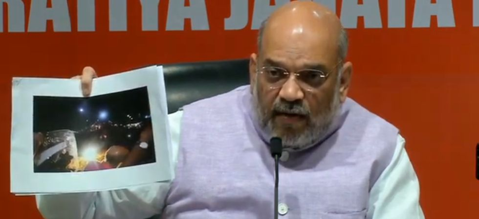 Tension was palpable since noon, hours before Amit Shah's roadshow began, after posters with images of PM Modi and him were dismantled by the police. (BJP/Twitter)