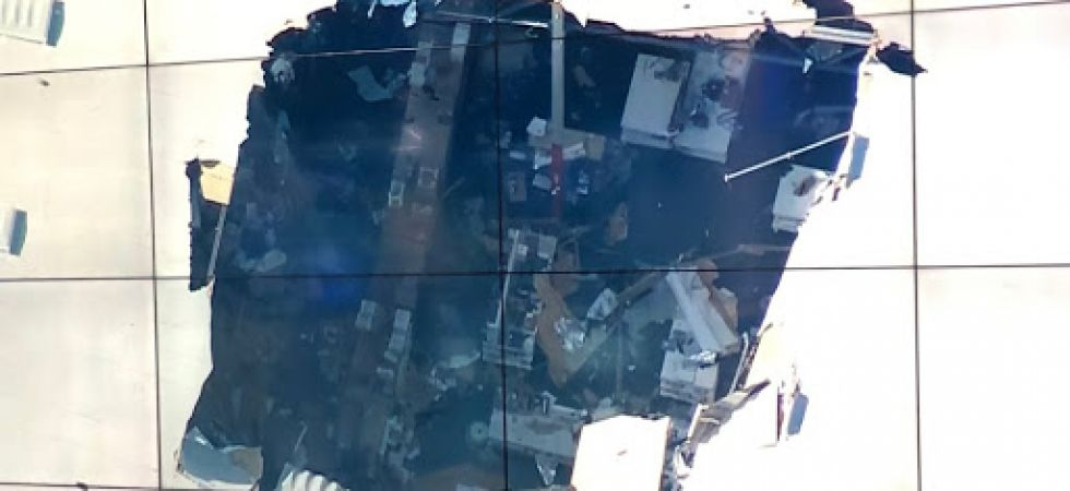 Television news shows a large hole in the roof of the building east of Los Angeles. Covington says there are no injuries on the ground. (Photo: Twitter)