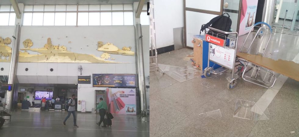 Lucknow: Wall decor at Chaudhary Charan Singh International Airport falls off, close shave for passengers. (Photos: ANI)