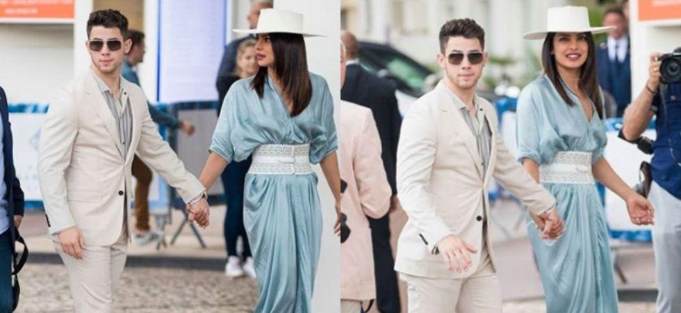Priyanka Chopra, Nick Jonas look amazing as they walk hand-in-hand at Cannes.