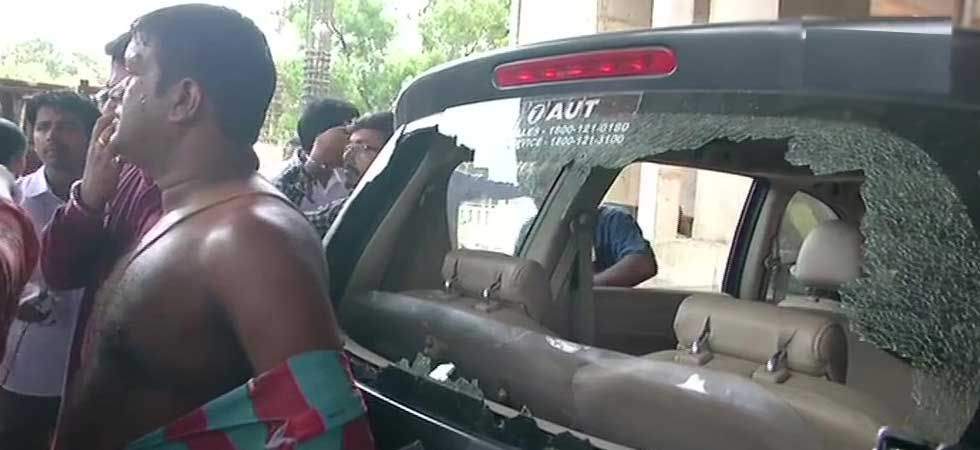 TMC workers allegedly attacked BJP workers and damaged a car in Jadavapur. (ANI Photo)