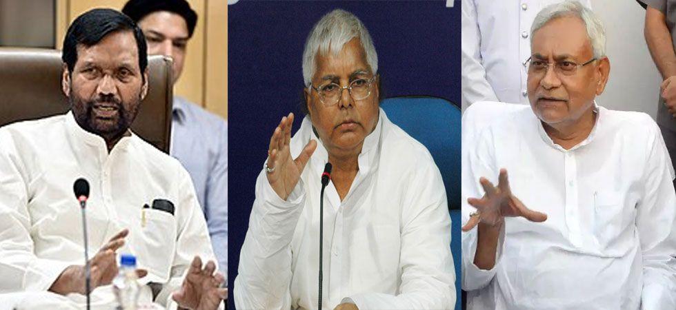LJP chief Ram Vilas Paswan, RJD leader Lalu Prasad and Bihar Chief Minister Nitish Kumar. (File Photo)