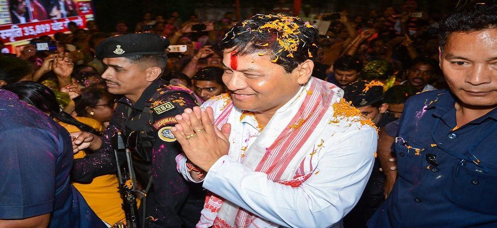 Assam Chief Minister Sarbananda Sonowal welcomed at the BJP office in Guwahati. (Photo: PTI)
