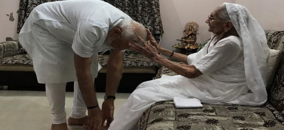 Prime Minister Narendra Modi with mother Heeraben Modi (Photo Source: BJP)