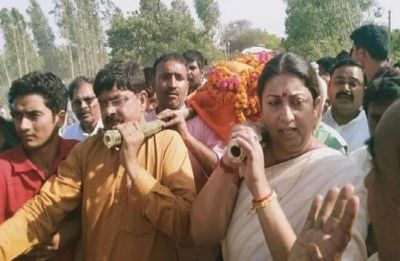 Smriti Irani lends a shoulder to mortal remains of her close aide Surendra Singh in Amethi