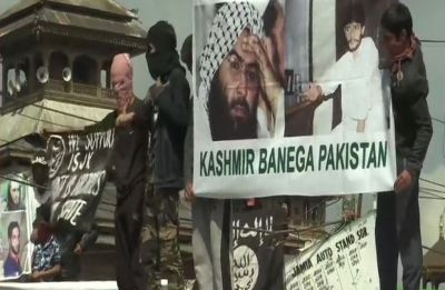 Stone-pelters clash with security forces in Kashmir, wave banners supporting Masood Azhar
