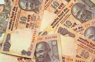 Rupee slips 19 paise to 69.45 against US Dollar ahead of RBI policy outcome