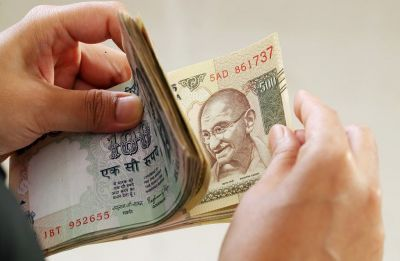 Rupee pares gains, settles 19 paise lower against US dollar