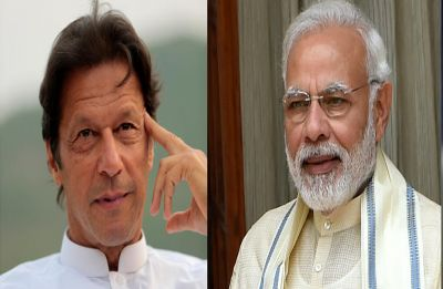 PM Narendra Modi exchanges usual pleasantries with Imran Khan in Leaders' Lounge at SCO Summit