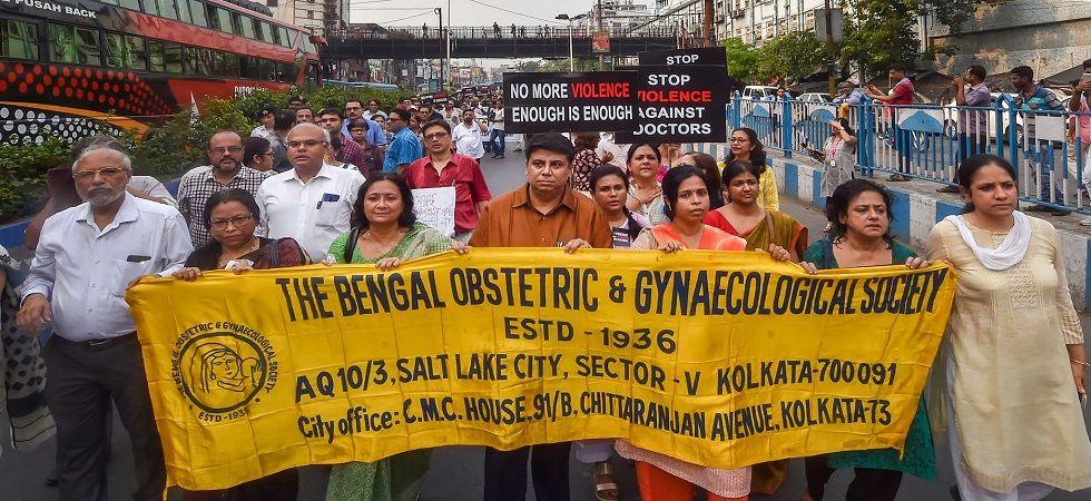 Members of the Joint Doctors Forum walk in solidarity with striking doctors in Kolkata. (Photo: PTI)