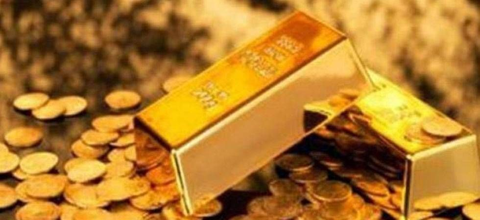 Gold slides by Rs 130 on muted demand, weak global cues