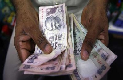 Rupee slips 11 paise to 69.05 against US dollar in early trade