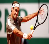 Federer into Slam third round for 70th time at Wimbledon