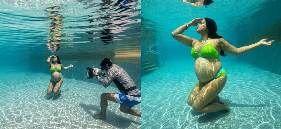 Sameera Reddy flaunts baby bump in swimwear for photoshoot.