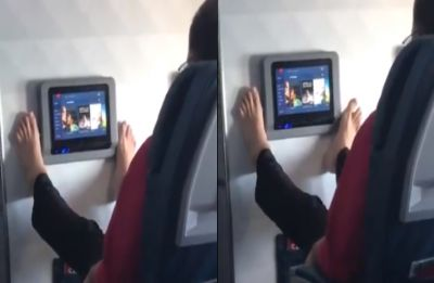 Watch: Airline passenger uses toes to operate in-flight entertainment, leaves internet divided