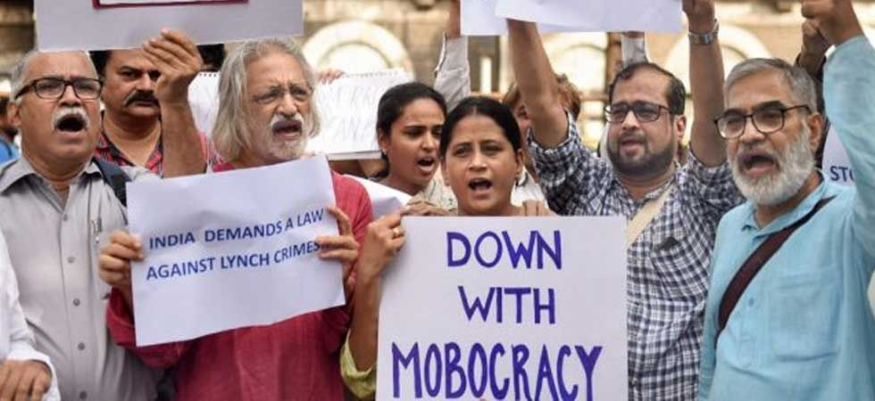 File photo of people protesting against mob lynching. (PTI Photo)