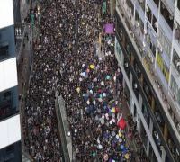 Hong Kong protesters egg China office during massive pro-democracy rally