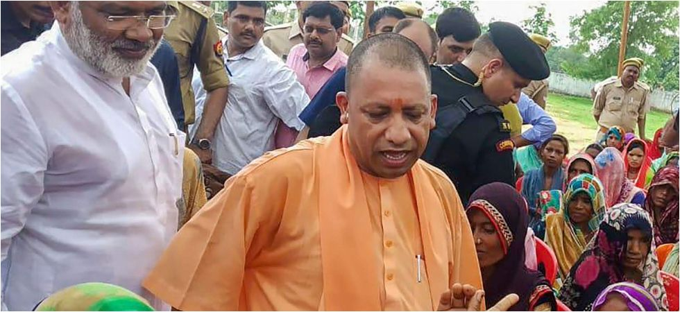 File photo of Uttar Pradesh Chief Minister Yogi Adityanath meeting villagers in Sonbhadra. (PTI)