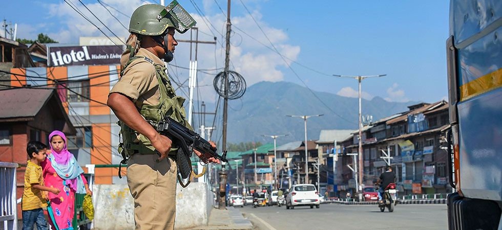 A CRPF personnel stands guard in Srinagar as the situation in the Valley continues to be tense. (PTI Photo)